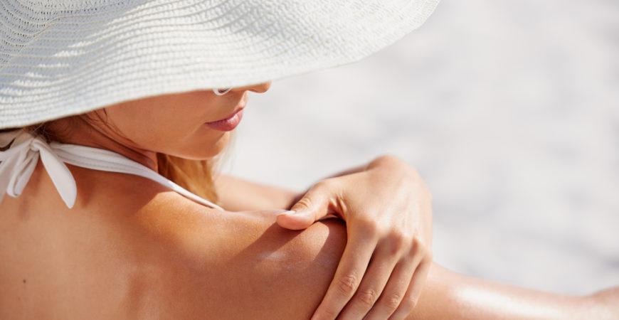 Woman applying sunscreen